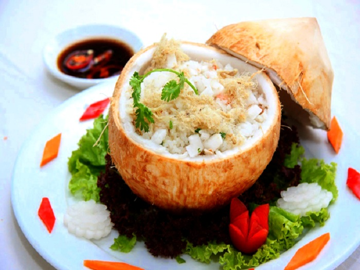 Travelling to Ben Tre Province – Western Region of Vietnam, you should not forget to enjoy rice cooked in coconut - Photo: Internet