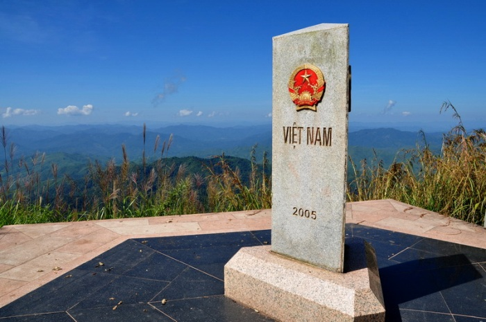 The milestone with its three sides craved with the name of three nations - Vietnam, Laos, PRC - is the Westernmost point of Vietnam mainland - Photo: Internet