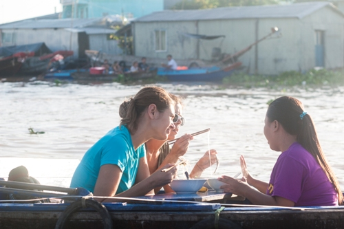 Eating while paddling along the river