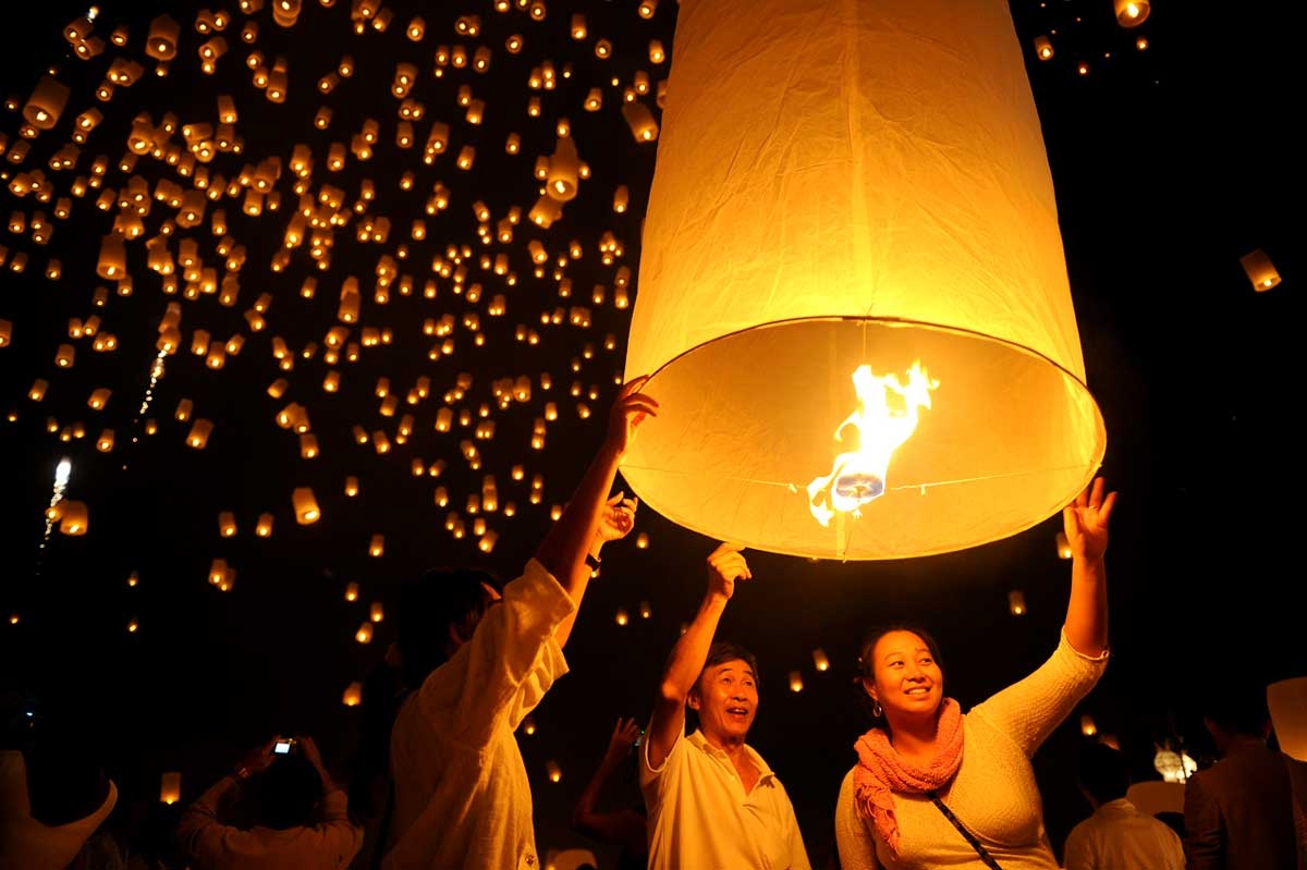 Thousands of lighted lanterns in the sky