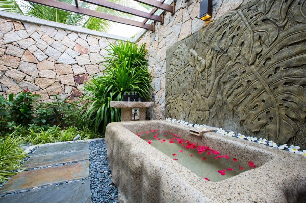 with hand-carved stone bathtub