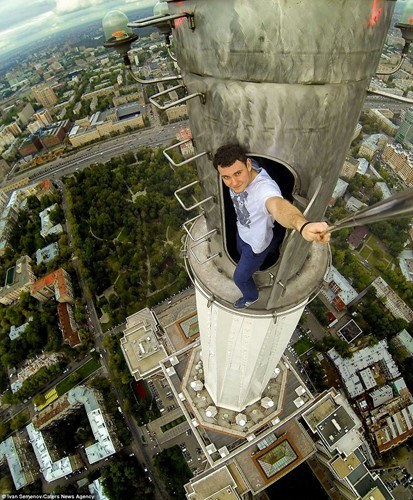"Lovely view but don't look down: one of the most extreme ""roof topping"" photos ever"