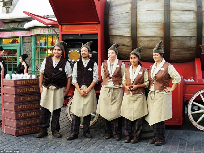 The staff serves butterbeer in impressive costumes