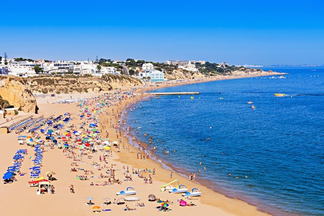 Albufeira, Portugal: is the preferred destination for summer holidays with beautiful beaches, lively nightlife, and charming old town.