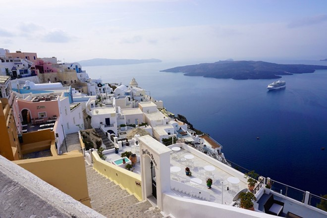 Fira, Santorini, Greece: Beach in Fira town is one of the most beautiful places in Santorini fairytale island. Come over here once in your lifetime to admire the stunning nature especially at sunset.