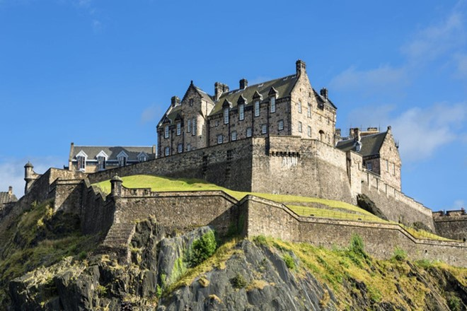 Edinburgh Castle is a historic fortress which dominates the skyline of the city Edinburgh of Scotland.