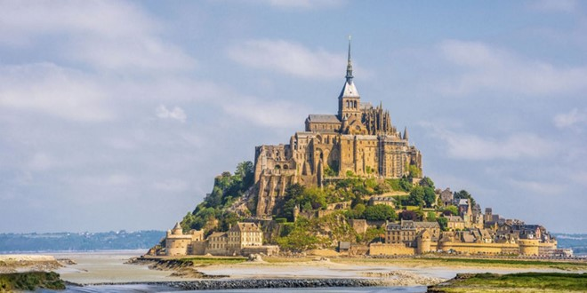 Mont Saint-Michel Castle in France located about one kilometre off the country northwestern coast.